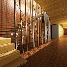 Two refurbished wine cellars in Spain feature undulating oak ceilings and stainless steel trees.