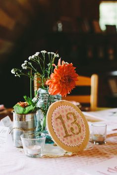 adorable fabric + glitter table numbers, photo by Brett & Jessica http://ruffledblog.com/lady-luck-farms-asheville-wedding #tablenumbers #centerpieces #wedding
