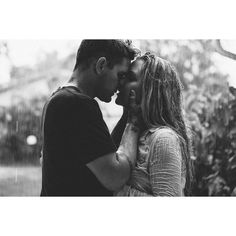 Kissing in the rain. We have 5 children, own a photography company, travel the country every summer, just adopted our daughter, love essential oils and love and respect each other. Taken by our 7 year old Organic Moments Photography ♥ A7rii Sony