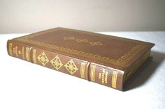 It is bound in leather and has a silk bookmark ribbon. The cover of the book has a wonderful gold design on front, back, and spine. Franklin Books, Library Signs, Affair, Decorative Boxes, Snow, Leather, Ebay, Decorative Storage Boxes, Library Signage