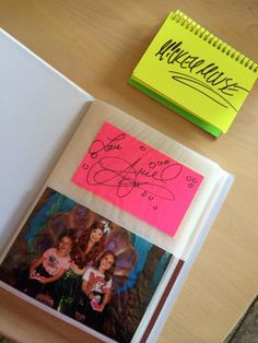 Neon Notecards on a spiral ring. Tear out later and put with photo of character. Disney World Autograph Idea