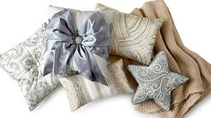 Shimmery pillows from Pier 1, including Silver Bow and Silver Beaded Star Pillows. For Christmas!