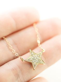 Hokule'a necklace gold star necklace shooting by kealohajewelry