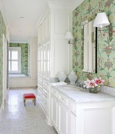 love the built-in armoire and the idea to place wallpaper behind the mirrors. Floor is good as well