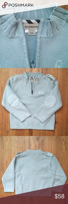 Burberry 3Y zip sweater Like new Burberry sweater. A gift given to my son that was never worn.   14.5 in Length  12.5 in Width  12 in sleeve  100% cotton Burberry Shirts & Tops Sweaters