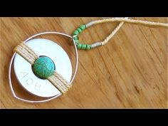 How to make a Medallion from a Washer and Bangle (1): wire would be prettier that the cord, I think.