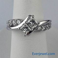 """14k White Gold 1.5ctw Diamond Two Stone Princess Cut """"Forever Us"""" Ring - $5399 ------------------ This extraordinary ring is made of 14k white gold and features the two stone """"Forever Us"""" setting with approximately .80 carat of diamonds in the 2 princess cut center stones and approximately .70 carat in adorning diamonds on the sides! Total diamond weight is one and a half carats! This ring retails for $7,000!  This low price is exclusively for Everjewel!"""
