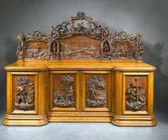 The Robinson Crusoe Sideboard by the  young Garrard Robinson  son of a Blacksmith  Young Robinson was under 26 when he carved the..I guess he got the idea from his own name.  What a legacy he left ...made in Newcastle upon Tyne see info below .