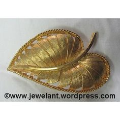 https://www.webstore.com/item,pgr,Decorative-Gold-Leaf-Pin,name,81711362,auction_id,auction_details