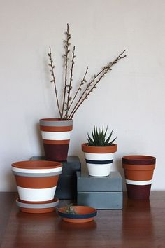 Striped Flower and Plant Pots (Photos © Steph Hung) Stripes may never go out of style, but sometimes they seem to undergo a resurgence of sorts. Inspired by the incredible Steven Alan collaboration with West Elm, cra. Painted Plant Pots, Painted Flower Pots, Painting Terracotta Pots, Terracotta Plant Pots, Decorated Flower Pots, Painted Pebbles, Clay Pot Crafts, Diy Crafts, Flower Pot Crafts