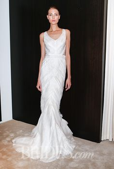 Brides.com: . Sleeveless sheath with ruffle details on skirt by J.Mendel