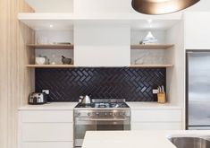 Matte Black Tile Kitchen Backsplash. This new DIY trend in remodels and redesigns is as beautiful in a bathroom as it is in a kitchen. A modern look if you're seeking subway tile alternatives.