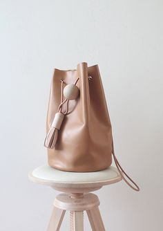 """a new brand called Building Block. Sisters Kimberly and Nancy Wu created this minimalistic collection of leather bags called """"Black"""" based on the concept of returning back to square one."""
