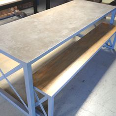 Concrete table and metal base by PlanksUSA