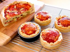 How to make pizza in springform pans. Wonderful deep dish pizza.   Small pans provide a reheatable lunch to take to the work place.