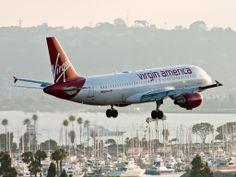 "Virgin America Airbus A320-214 N629VA ""Midnight Ride"" on final approach to San Diego-Lindbergh, July 2010. (Photo: Ryan Pastorino)"