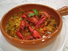 Guiso tradicional de las zonas marismeñas de Andalucía con un toque final de horno.