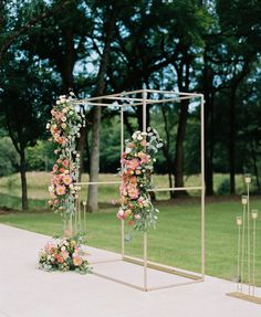 Golden square arch with assymetric florals and power punches of color!!! Coral Peonies for the win!!! Photo Credit: Erin Wilson Photography