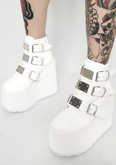 Demonia Icy Low Trinity Boots have ya entering the matrix, except yer on a whole other level. These badass boots have buckles on the sides, killer platforms and back zipper closure to keep ya futuristic.
