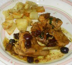 Coniglio con olive e patate al forno