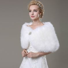 This fluffy Wedding cape is made of High Quality soft faux fur with fully lined with rhinestone Brooch  It is perfect for your wedding or other