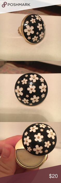 Daisy by Marc Jacobs perfume ring A playful fragrance accessory with a vintage feel. A mod enamel, black daisy ring twists to reveal the solid perfume inside. Fragrance notes grapefruit, violet leaves, strawberry, gardenia, jasmine, violet, wood musk and vanilla Marc Jacobs Jewelry Rings