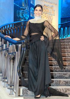 Deepika Padukone was seen donning a black ensemble with silver detailing around the neck at the Lakme Fashion Week 2015.