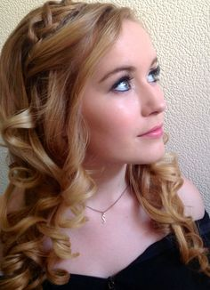 Soft curls with a Celtic braid across the top. Bride bridal wedding hair down curly plait Irish