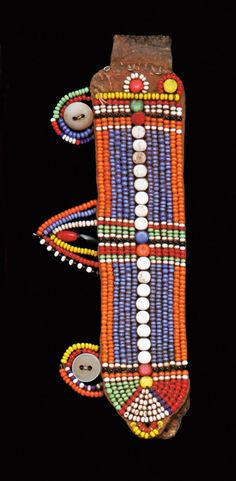 Africa   Beaded Earflap from the Masai people of Kenya   20th century   Leather embroidered with glass beads and buttons   These types of ear ornaments are worn only by married women.