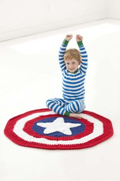 "Little Super Hero Blanket - SKILL LEVEL:  Easy SIZE: Finished diameter: About 39"" MATERIALS: Hometown USA Solids balls: Fort Worth Blue 2; Cincinnati Red 3; New York White 3: N hook"