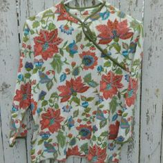Flower print blouse 3/4 sleeve, beautifully bold flowers with short V-neck into button peep. Only worn a handful of times, next to new. Talbots Tops