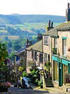 Haworth Main Street. Haworth is a village in the City of Bradford metropolitan borough of West Yorkshire, England. It is located in the Pennines, 3 miles southwest of Keighley and 10 miles west of Bradford. The surrounding areas include Oakworth and Oxenhope. Wikipedia Yorkshire Dales, Yorkshire England, North Yorkshire, Cornwall England, England And Scotland, England Uk, London England, Oxford England, Travel England