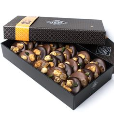 Michel Cluizel has been making chocolate in the southern Normandy region of France to an exclusively high standard, in the French chocolate making tradition, since 1948. Mendiants are made of nuts, al