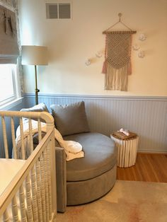 LOVE the round chair in the corner of this nursery!