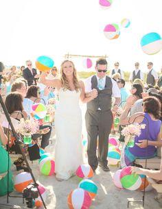 Beach wedding ceremony exit with beach ball toss
