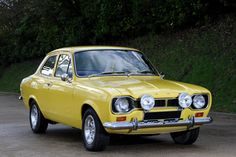 Ford Escort like my baby !I passed my test in one of these beuties Escort Mk1, Ford Escort, Classic Motors, Classic Cars, Retro Cars, Vintage Cars, British Sports Cars, Yellow Car, Best Muscle Cars