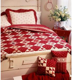 striking red and white quilt and pillows