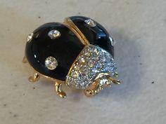 Joan Rivers Vintage Lady Bug Rhinestone Enamel Brooch 984 by OzarkFarmGirls on Etsy https://www.etsy.com/listing/261115904/joan-rivers-vintage-lady-bug-rhinestone