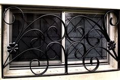 """Our company uses ONLY uniformly punched channel iron horizontals and <solid steel pickets in our standard designs which create a zero break point in the design. Also as the standard construct we also utilize """"free of charge"""" towards custom design Burglar Bars Houston inserts."""