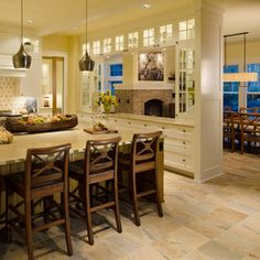 I just like this set up but maybe between the kitchen and breakfast room more than the formal dinning room