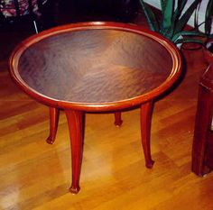Majorelle table ca. 1910. The material in the top is unlackered Cuban mahogany showing a very  strong chatoyance.