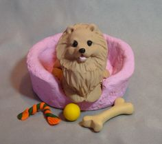 Clay Pomeranian Dog sculpture by Laurie Valko, via Flickr