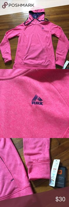 Women's RBX pink sweatshirt NWT Has 3 flaws on the from near the RBX logo. Looks like the dye from the logo threat leaked onto the shirt. It is pictured. They aren't super dark. New with tags!! RBX Tops Sweatshirts & Hoodies