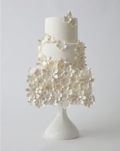 12 All-White Wedding Cakes: We love the 3-dimensional petals on this 3-tier cake