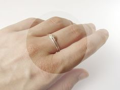Delicate stacking rings. Two leaves. Sterling silver and copper. $33.00, via Etsy.