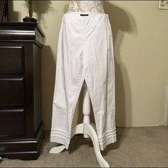 Jones New York White Cropped Pants 🌞 🌾Classy white pants with a beautiful border stitched on the bottom of each pant leg. There is the ever so slightest spot on the back of the left leg just below the knee (see pic #4). Wore only a few times. Unfortunately my waist outgrew them. 😐  Match well with the black & white top listed in my closet. Are great for a night out or an afternoon out shopping (when you're not poshing!). 😊 Jones New York Pants Ankle & Cropped