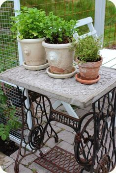 cement topped vintage sewing machine base as outdoor planter table