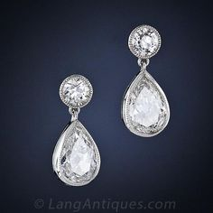 A wonderful and wearable pair of classic platinum and diamond ear drops featuring two pair of matched vintage diamonds: A pair of pear shape, or teardrop diamonds, weighing 1.30 carats total, dance below a pair of round European-cut diamonds weighing between .35 and .40 carat total.These beautiful and timeless vintage style earrings are newly made using original antique-cut diamonds.