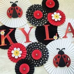 A little lady bug is having a birthday!  #ladybug #ladybugbirthday #ladybugtheme #ladybugpartyideas #imalady #blackandwhite #girlbirthday #girlbirthdaythese #partydecorations #partyplanning #backdrop #pinwheels #paperfans #glitter #girly