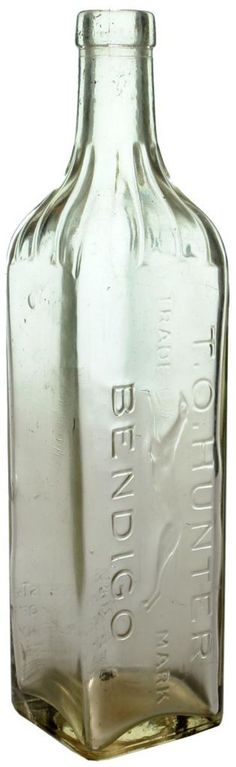 T. O. Hunter, Bendigo. Clear glass, square section cordial bottle with fluted neck decoration. Greyhound trade mark. c1920s-1930s